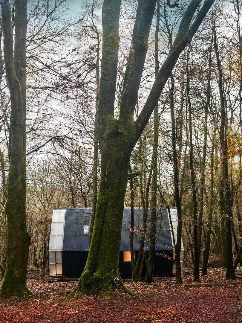 Invisible Studio combines home-grown timber and construction waste materials in an economical self-built relocatable house