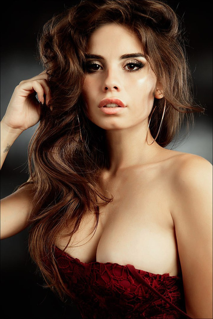 Brunette hair gal with merry bosom gives