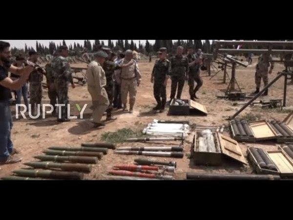 6.05.18 - Выставка бронетехники и вооружений, сданных боевиками в Растанском анклаве перед началом их вывоза. Небольшое авиашоу на