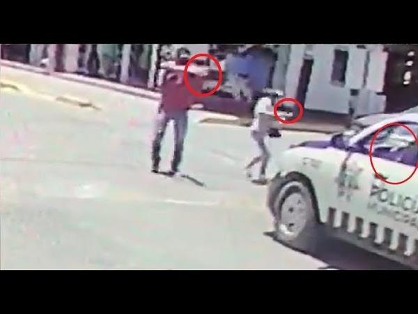 Shocking moment gunmen ambush mexican police at traffic light